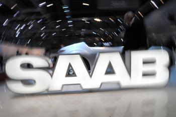A logo of the Swedish car manufacturer Saab owned by General Motors is displayed during the 79th Geneva Car Show on March 3 in Geneva. Saab faces an uncertain future as its market share drops and parent General Motors struggles to survive. (Fabrice Coffrini/AFP/Getty Images)