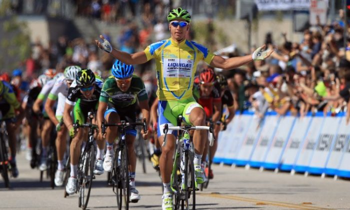 Peter Sagan celebrates as he crosses the finish line to win Stage Two of the Tour of California ahead of Heinrich Haussler and Leigh Howard. (Doug Pensinger/Getty Images)