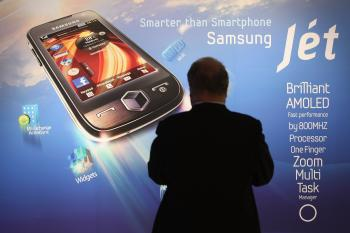 A visitor stops at a poster for Samsung's new Jet smartphone at the Samsung stand on opening day at the IFA technology trade fair on September 4, 2009 in Berlin, Germany. (Sean Gallup/Getty Images)