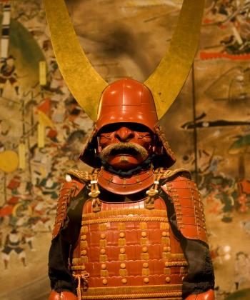 Majestic 17th century cuirass 'gusoku' armor with red lacquer and smoked-leather lacing, on display at the Metropolitan Museum of Art beginning Wednesday. (Bohdan Skorbach/The Epoch Times)