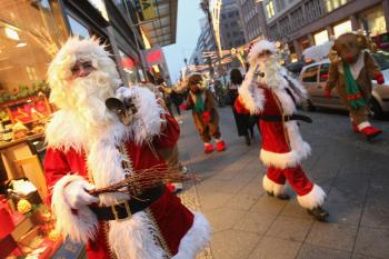 'Santa Claus-free zones' were requested by a Catholic group this week, media reports say. Pictured above, actors dressed as Santa Claus and reindeer greet shoppers outside a department store on December 11, 2008 in Berlin, Germany.  (Sean Gallup/Getty Images)