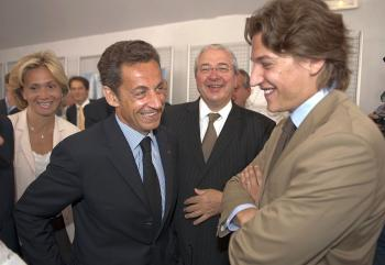 France's President Nicolas Sarkozy (2ndL) speaks with his son Jean Sarkozy (R) as they visit an exhibition as part of the Grand Paris project.  (Philippe Wojazer/AFP/Getty Images)