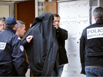 French policemen arrest a man suspected to be in connection with death threats received by French president Nicolas Sarkozy and several ministers, on March 4, 2009, in Montpellier, southern France.   (Pascal Guyot/AFP/Getty Images)