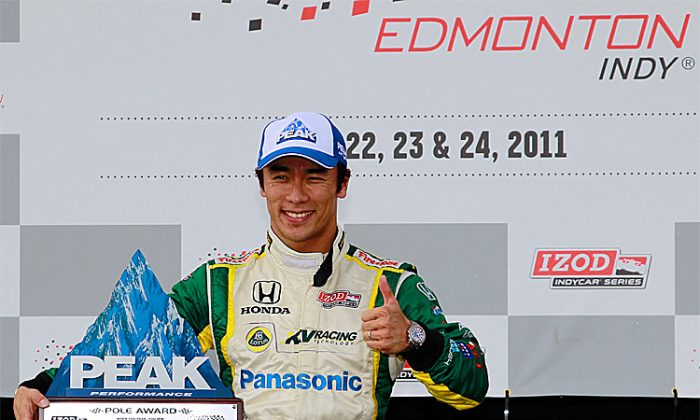Takuma Sato celebrates winning the pole after qualifying for the IZOD IndyCar Series Indy Edmonton, July 23, 2011. (Chris Trotman/Getty Images)