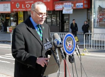WHO IS DRIVING THE BUS? Sen. Charles Schumer spoke on Sunday in favor of having the DMV audit all drivers licenses for tour bus drivers. (Catherine Yang/The Epoch Times)
