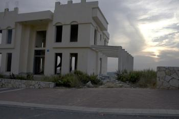 A partially built house stands waiting in the settlement of Kedumim. (Genevieve Long/The Epoch Times)