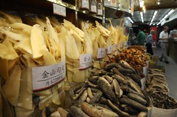 CRUEL CATCH: People shop as shark fins are displayed for sale in Hong Kong's Shueng Wan district. (Dale de la Rey/AFP/Getty Images)