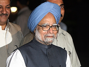Indian Prime Minister Manmohan Singh talks to media representatives after the vote of confidence at Parliament house in New Delhi on July 22, 2008. (Raveendran/AFP/Getty Images)