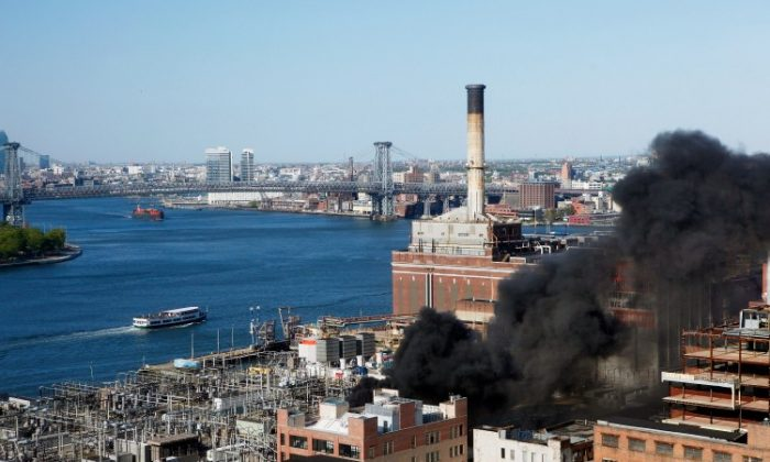 Smoke rises from a Con Edison power plant after a small explosion and fire broke out in DUMBO, Brooklyn, on Sunday. Residents reported hearing an explosion and felt homes shaking. No injuries were reported. (Beth A. Keiser/Getty Images)