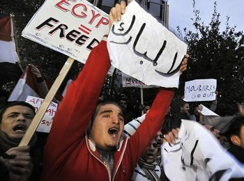 Egyptians living in Athens carry placards reading ''Mubarak go'' and ''Egyptian equal freedom'' during a protest against Egyptian president Hosni Mubarak's regime, outside the Egyptian embassy in Athens, on January 28, 2011. Demonstrations in Egypt, inspired by the 'Jasmine Revolution' in Tunisia, have swelled into the largest uprising in three decades, sending shockwaves across the region. (Louisa Gouliamaki/AFP/Getty Images)