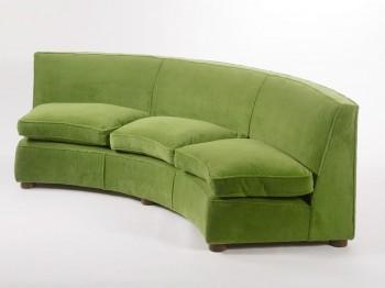 RETRO SOFA: This original Jean Royere 'Arc de Cercle' sofa, circa 1950s, is estimated at $40,000 to $60,000. (Courtesy of Sotheby's)
