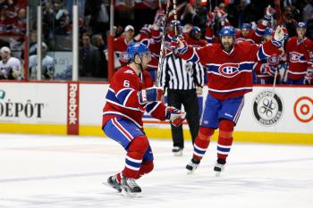 BACK IN THE SADDLE: Jaroslav Spacek (left) celebrates after scoring Montreal's third goal. The veteran defenseman made his long-awaited return to the lineup on Wednesday. (Richard Wolowicz/Getty Images)