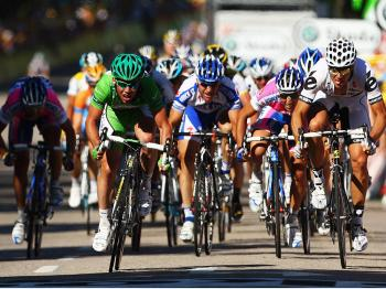 Mark Cavendish races for the green jersey at the end of Stage Twelve. (Bryn Lennon/Getty Images)