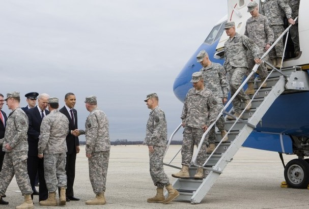 U.S. President Barack Obama (6th L) and U.S. Vice President Joe Biden (4th L) greet troops during a ceremony to mark the return of the U.S. Forces-Iraq Colors and the end of the Iraq war on Dec. 20, at Joint Base Andrews, Md. The last U.S. troops left Iraq on Dec. 18, ending the war after nearly nine years. (Kristoffer Tripplaar-Pool/Getty Images)