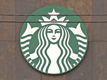 COMPETITOR: Starbucks Center, headquarters for the international coffee and coffeehouse chain, is seen last March in Seattle, Washington. Starbucks is still competing aggressively worldwide as it turns 40. (Mark Ralston/AFP/Getty Images)