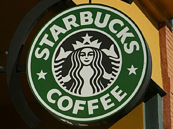 DISMAL REPORTS: Signs are seen in the front of a Starbucks coffee shop January 22, 2004 in San Francisco, California. In an effort to cut costs, the coffee chain announced July 29, 2008 that it was laying off 1000 non-store employees. (Justin Sullivan/Getty Images)