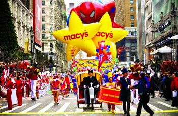 Participants in the 83rd Annual Macy's Thanksgiving Day Parade greet onlookers as they march through Manhattan on Thursday. (Aloysio Santos/The Epoch Times)