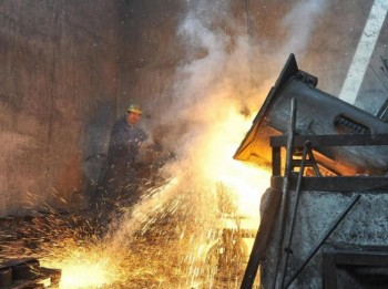 A steel worker watches over a furnace at an iron-steel factory in Wuhan, central China's Hebei province. China's GDP growth is dominated by government investment, which in many areas is worryingly high. (STR/AFP/Getty Images)