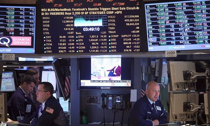 Traders work on the floor of the New York Stock Exchange during afternoon trading on May 29 in New York City. The Dow Jones Industrial Average gained 125 points, finishing the day at 12,580 points, a gain of 1 percent. (Mario Tama/Getty Images)