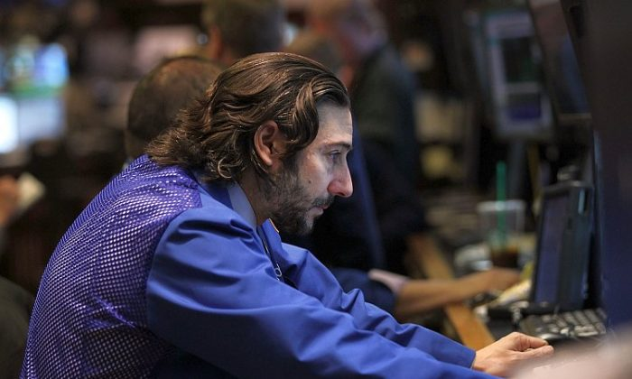 A trader looks at his screen at the New York Stock Exchange on Feb. 3. Markets reacted positively last Friday to a U.S. jobs report showing growth in the job market. (Spencer Platt/Getty Images)