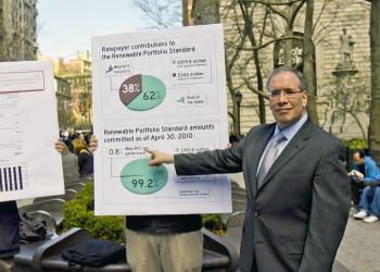 FAIR SHARE: Manhattan Borough President Scott Stronger points at a chart showing the share of renewable energy projects New York City has received from the state. (Phoebe Zheng/The Epoch Times )