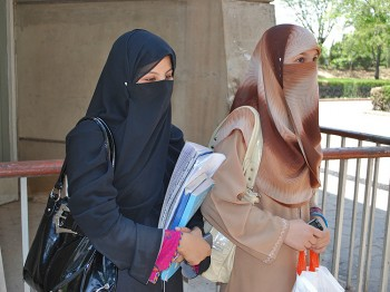 DRESS OF CHOICE: Sania Shah (R), walks with a friend at a local college in Islamabad. Shah says she wears a burqa out of choice, because it makes her feel secure. (Masooma Haq/The Epoch Times)