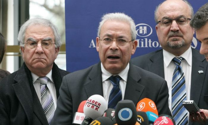 Burhan Ghalioun leader of the Syrian National Council opposition speaks to the press in Ankara March 13. Two prominent members announced their resignation from the council on Wednesday (Adem Al Tan/AFP/Getty Images)