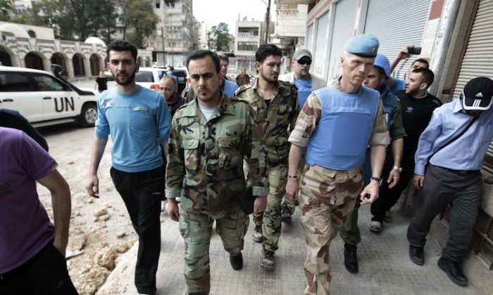 Norwegian Major-General Robert Mood (C-R), head of UN observer mission in Syria (UNSMIS) and Free Syrian Army commander Abu Kutaiba (C-L) arrive for a meeting in the restive Khalidiya district of the central Syrian city of Homs on May 3. (Joseph Eid/AFP/GettyImages)