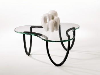 FOR AUCTION: A Jean Royere coffee table and the Georges Jouve sculpture sitting on top, both estimated at $15,000 to $20,000. (Courtesy of Sotheby's)