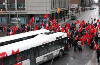 Tamil protesters block traffic at an intersection in Ottawa.  (Samira Bouaou/The Epoch Times)
