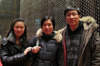 Mr. Tang, a new immigrant from mainland China, attends Divine Performing Arts Chinese New Year Spectacular with his mother and wife. (Li Jia / The Epoch Times)