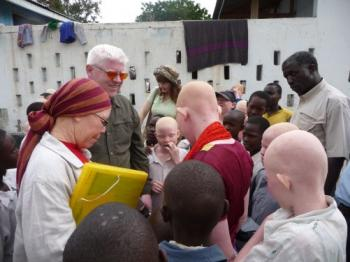 Peter Ash and MP Al-Shaymaa Kwegyir greet children at a school in which albino children have been staying to escape assailants hunting for body parts. (Don  Sawatzky/Under the Same Sun)