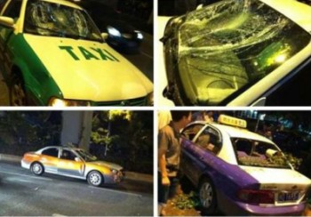 Non-striking drivers' taxis are damaged by striking drivers.  (Weibo)