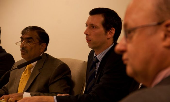 (From L to R) Rahul Merchant, Department of Information, Technology, and Telecommunications commissioner; Brett Robinson, deputy commissioner for financial management and administration; and general counsel Charles Fraser, at a City Council Executive Budget Hearing on Tuesday. (Zachary Stieber/The Epoch Times)