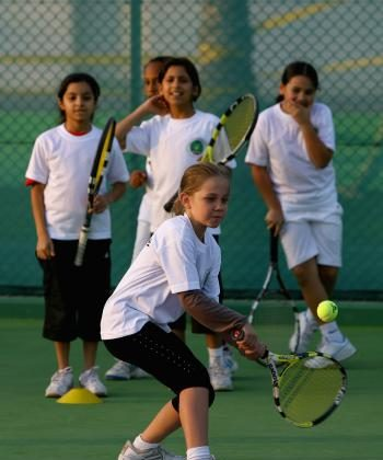 """Children learning to play tennis. A recent report says more than 80 percent of Canadians believe that """"promoting positive values in youth should be a priority for sport in Canada.""""  (Brunskill/Getty Images)"""
