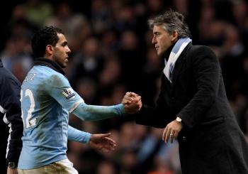 Carlos Tevez and Roberto Mancini are back on good terms after the striker bagged two goals against Wolves on Saturday. (Alex Livesey/Getty Images)