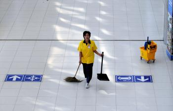A worker cleans the international arrival lounge after anti-government protesters left Suvarnabhumi international airport in Bangkok on December 3, 2008. (SAEED KHAN/AFP/Getty Images)