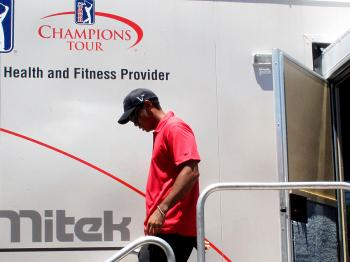 Tiger Woods walks out of the player fitness truck after withdrawing from the final round of The Players Championship tournament at TPC Sawgrass. (Scott Halleran/Getty Images)
