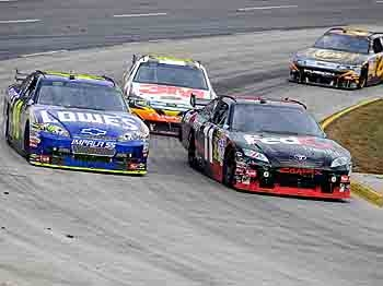 Denny Hamlin in the #11 FedEx Freight Toyota, leads Jimmie Johnsonn the #48 Lowe's Chevrolet, Greg Biffle in the #16 3M/Filterete Ford, and David Ragan in the #6 UPS Ford, during the NASCAR Sprint Cup Series TUMS Fast Relief 500 at Martinsville Speedway on October 25, 2009 in Martinsville, Virginia. (John Harrelson/Getty Images)