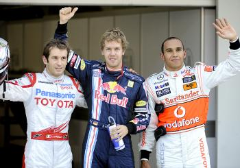 Sebastian Vettel (C) gives a thumb up, while Jarno Trulli (L) and Lewis Hamilton celebrate after qualifying for the Formula One Japan Grand Prix. (Yoshikazu Tsuno/AFP/Getty Images)