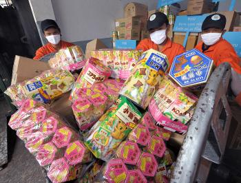Thai officials collect Chinese food products tainted melamine prior to destruction. Contaminated Chinese foods poisoned tens of thousands in China and were shipped all over the world. After contaminated toothpaste, dog food, fish, and lead paint in toys,  (Pornchai Kittiwongsakul/AFP/Getty Images)