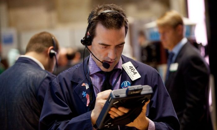 A trader works on the floor of the New York Stock Exchange this week. U.S. stocks stumbled on Tuesday, after soaring to a 12-month high on Monday. (Andrew Burton/Getty Images)