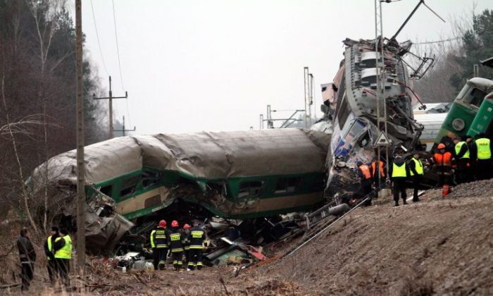 Rescuers work at the scene of a train crash in Szczekociny near Zawiercie (Silesia) in Poland, on March 4. Two passenger trains collided on March 3, killing at least 15 people and injuring another 59. An investigation into the crash was launched on Sunday. (Jacek Bednarczyk/AFP/Getty Images)