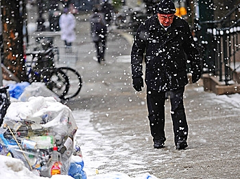 Snow piles up over trash piles. When the snow melts, some of the ugly wastefulness of 21st century society is revealed. (Emmanuel Dunand/AFP/Getty Images)