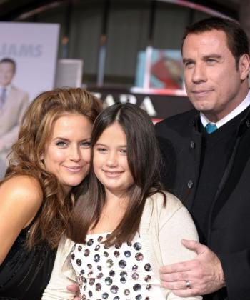 Actors John Travolta (R), wife Kelly Preston (L) and their daughter Ella Bleu Travolta arrive at the premiere of Walt Disney Pictures' 'Old Dogs' at the El Capitan Theater on November 9. (Kevin Winter/Getty Images )