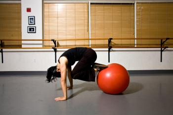 BALL TUCK: Be sure to pull your abdominal muscles inward (toward your spine) while performing this exercise. It is a great ab exercise. (Henry Chan/The Epoch Times)