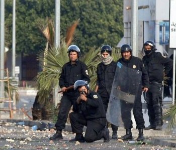 Tunisian security forces seen in the city of Regueb, Tunisia, on Monday. According to rights groups security forces killed at least 23 protesters last weekend. (STR/AFP/Getty Images)