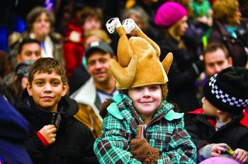 A group of children attend the 83rd Annual Macy's Thanksgiving Day Parade on Thursday. Each year more than 3 million people attend the parade and 44 million watch it on television. (Aloysio Santos/The Epoch Times)