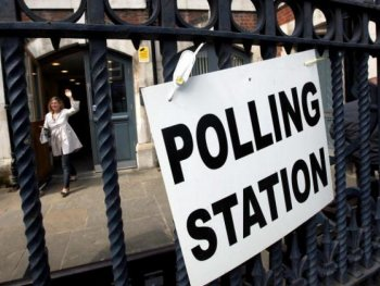 British Election Exit Poll: A woman leaves a polling station on Brick Lane after casting her vote on May 6, 2010 in London, UK. (Dan Kitwood/Getty Images)