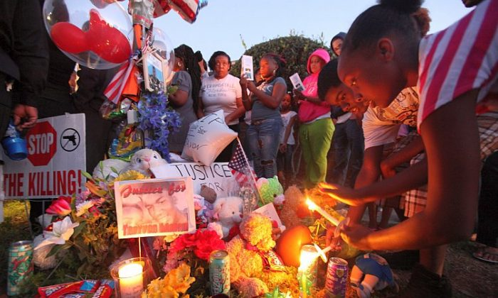 Supporters gather during a candelight vigil at a memorial to Trayvon Martin outside The Retreat at Twin Lakes community where Trayvon was shot and killed by George Michael Zimmerman while on neighborhood watch patrol in Sanford, Florida. (Mario Tama/Getty Images)
